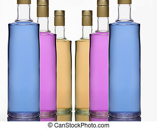 BOTTLES WITH LIQUIDS OF DIFFERENT COLORS