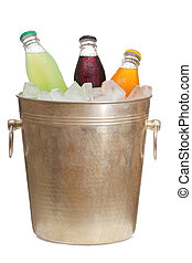 Bottles with soda in ice bucket