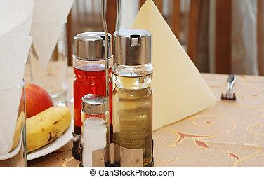 bottles with spices - salt, black p