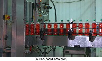 Bottling of juice in plastic bottles.