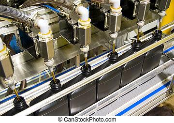 Bottling process 2 - Oil is dispensed into quart bottles at ...