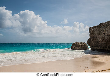 Rugged cliffs at Bottom Bay on the Atlantic south east coast of the Caribbean island of Barbados in the West Indies.