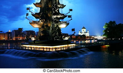 Bottom illuminated monument to Peter Great and fountains on River