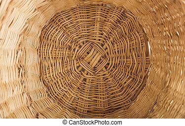 Bottom of a wicker basket.