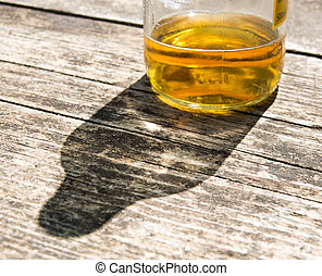 bottom of alcoholic bottle under the sun