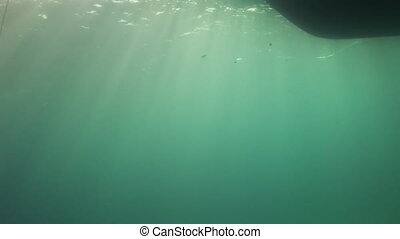 Bottom of  boat out of water on background of sun.