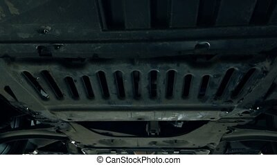 Bottom of the car and exhaust pipe 4K zoom in shot. Car...