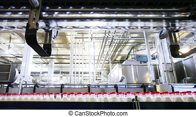 bottom row plastic bottles with milk and top of empty move at factory