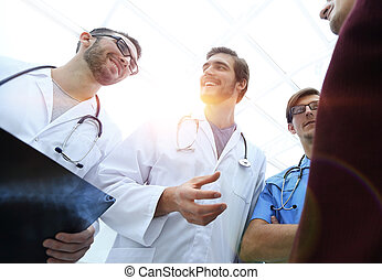 group of doctors advising the patient - bottom view. a group...