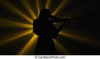 Bottom view black silhouette of a woman musician playing the...