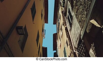 Bottom view of facades in old Florence