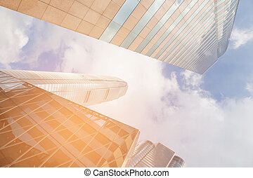 Bottom view office building with blue sky background