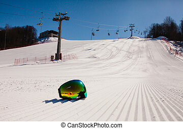 Bottom view on empty ski slope and equipment for...
