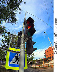 Bottom view on traffic light and road sign closeup