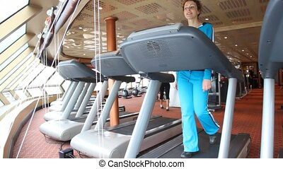 bottom view on woman exercising in gym