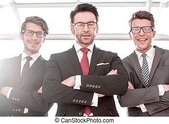 bottom view. three smiling business partners. concept of ...