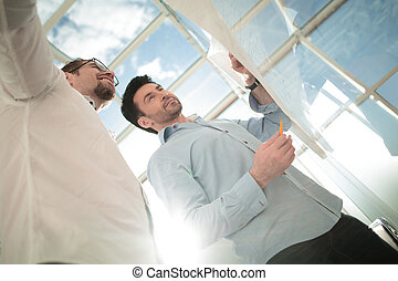 bottom view. two architects discussing a new project. photo ...