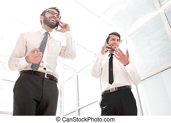 bottom view. two successful businessmen talking on their ...