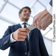 bottom view.business hands over his business card