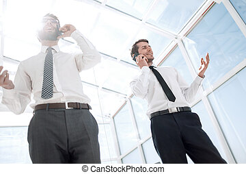 bottom view.business partners are talking on a mobile phone