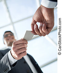 bottom view.business people exchanging their business cards.