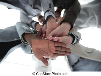 bottom view.business team folded their hands together