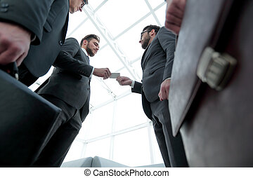 businessman handing business card to the partner.