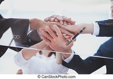 bottom view.closeup.business team showing their unity. the concept of teamwork