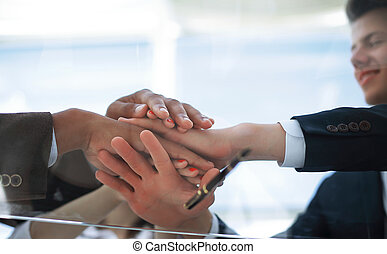 bottom view.closeup.business team showing their unity