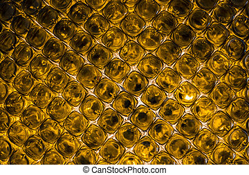 bottoms of empty orange glass bottles
