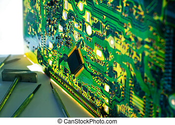 bouble exposure electronic circuit bord and tools repair for background, soft focus and blur