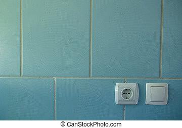 bouchon, mur bleu