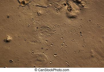 boue, cratères