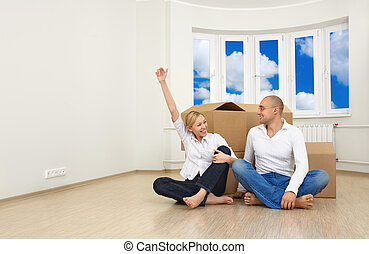 Bought a new flat - A man and a woman are happy with their...