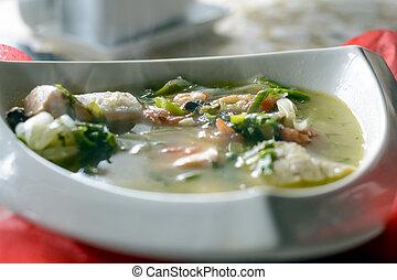 Bouillabaisse fish soup with seafood, salmon fillet, shrimp, rich taste, tasty dinner