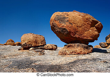 Big boulders lying on top of a large solid rock: Landscape at Augrabies Falls area; South Africa