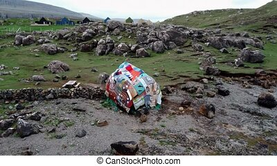 Boulder covered with blankets in Faroe Islands - Flying ...