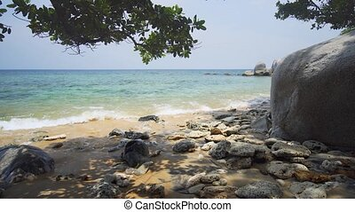 Boulder Strewn Tropical Beach from the Shade, with Sound - ...