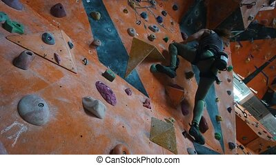Bouldering. Entertainment center. A woman fell off the wall ...
