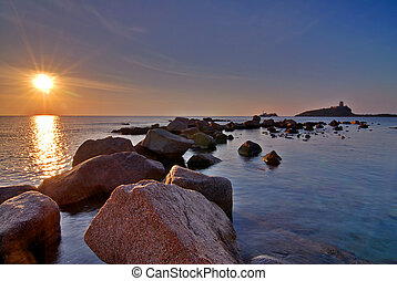 Boulders and sunrise - Sunrise in Sardinia with lighthouse...