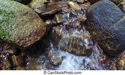 Boulders in the bed of a natural, mountain stream