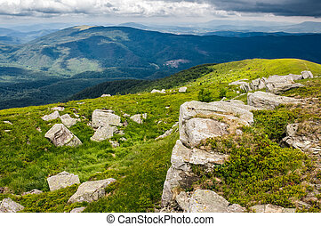 boulders on a grassy slope of mountain ridge - boulders on a...