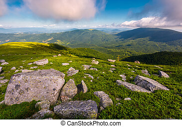 boulders on grassy hill in summer. lovely nature scenery...