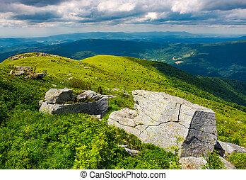 boulders on grassy hills. beautiful mountainous landscape....