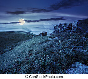 boulders on hillside in high mountains at night - huge...