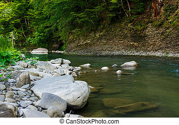 boulders on the shore of the river. lovely nature scenery in...
