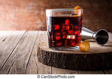 Boulevardier cocktail and orange zest in glass