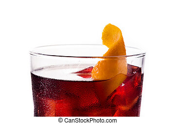 Boulevardier cocktail and orange zest isolated on white ...