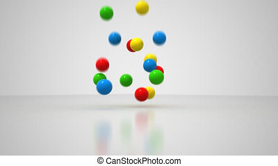 Multicolored bouncing balls falling onto a white floor until the balls settle.