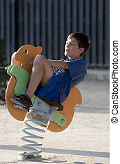 Bouncing boy - Child bouncing on horse toy